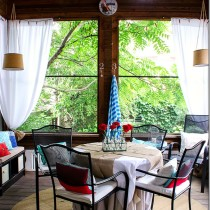 screen-porch-red-turquoise-blue-drapes