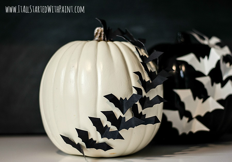 Bats flying across a pumpkin White pumpkin carving ideas