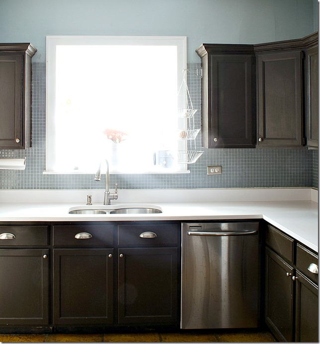 kitchen dark counters white counter and blue backspash