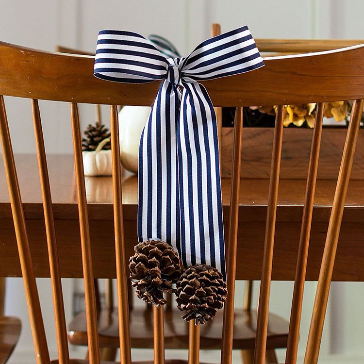 Decorating Backs of Dining Room Chairs with Ribbon and Pine Cones