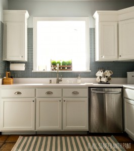 White Kitchen with Painted Builder Grade Cabinets, Blue Gray Tile Back Splash, White Counter Top