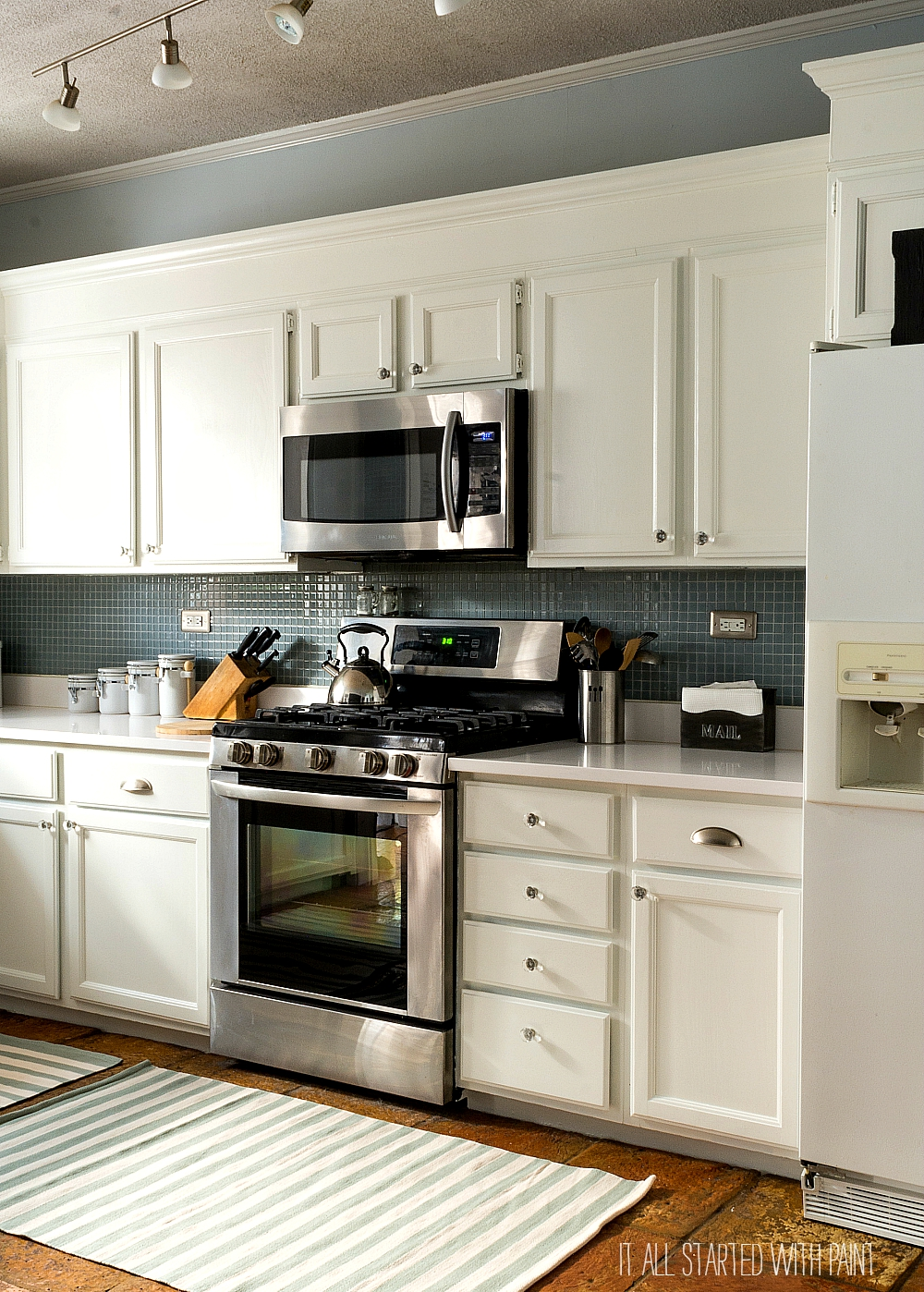 Builder grade kitchen makeover with white paint for How to paint white cabinets