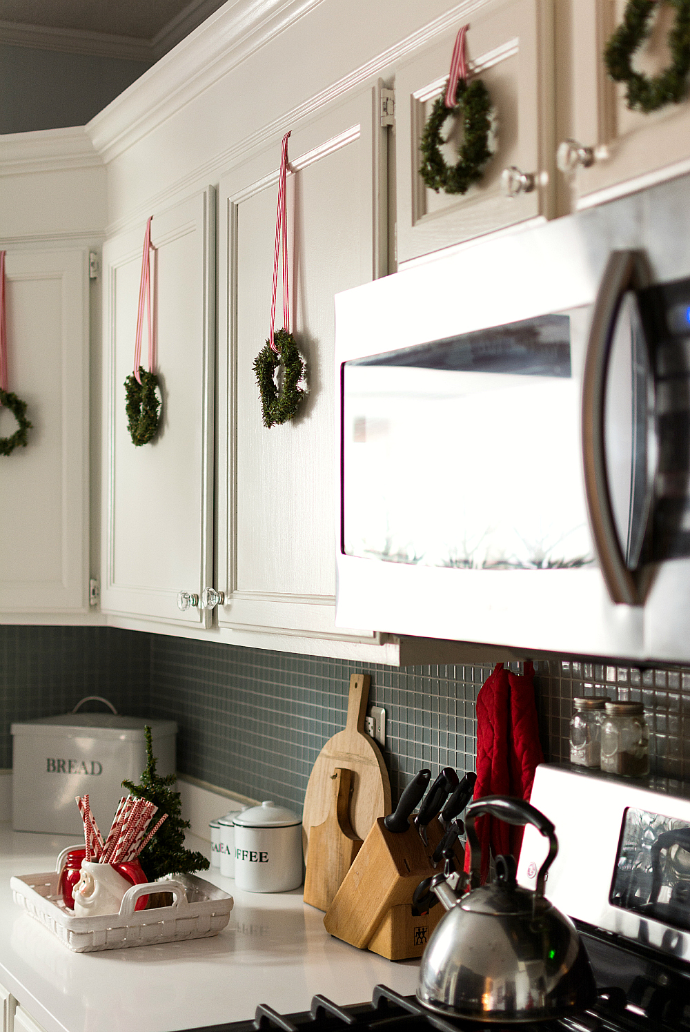red white christmas decor in the kitchen - Christmas Decorations For Kitchen Cabinets