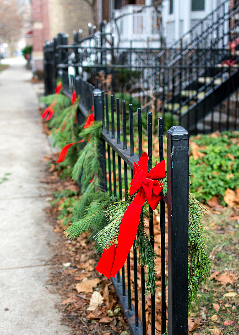 Christmas Decor Outdoors with Garland and Red Bows