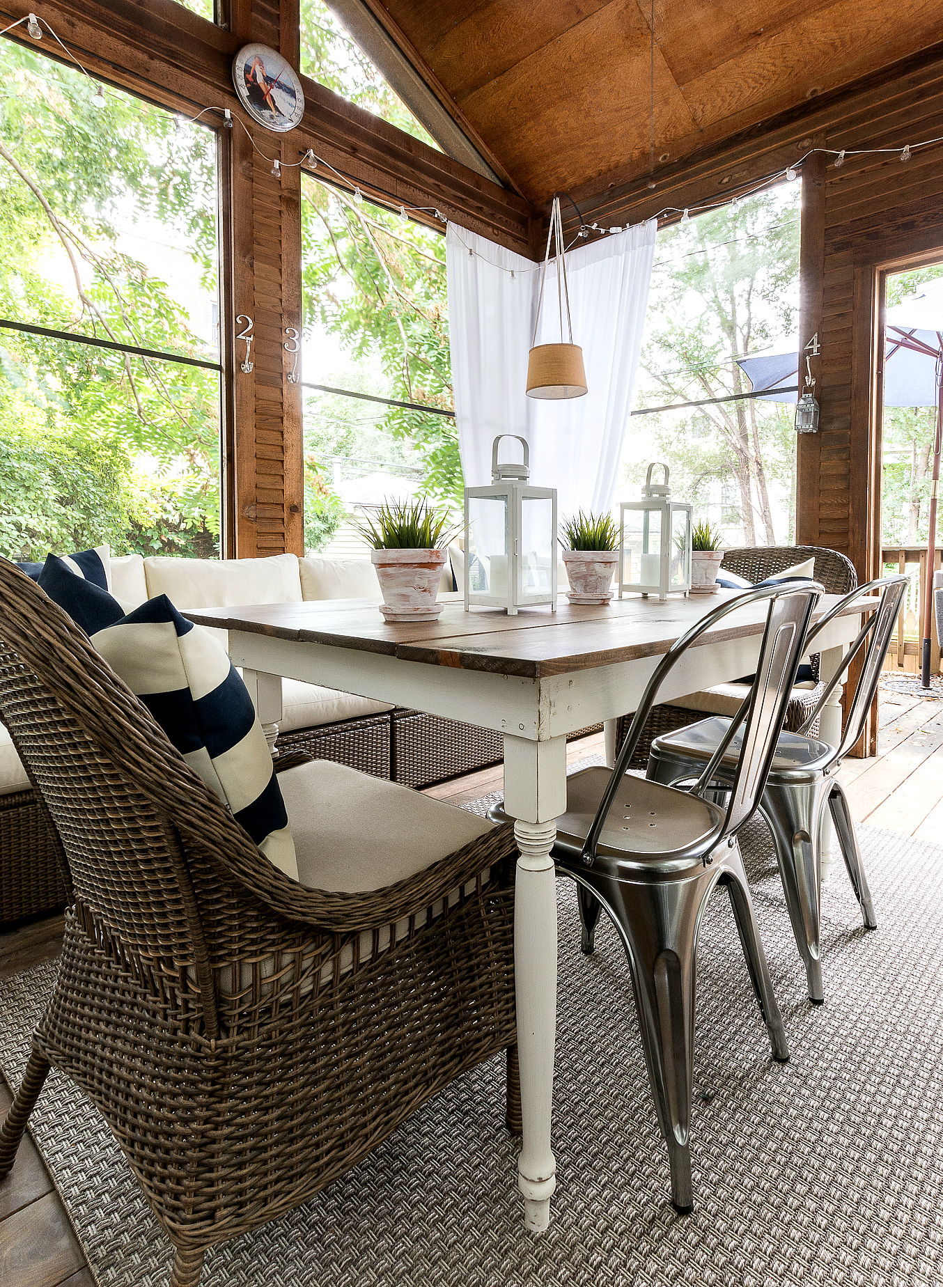 farmhouse-table-wicker-and-metal-chairs-screen-porch-3-1