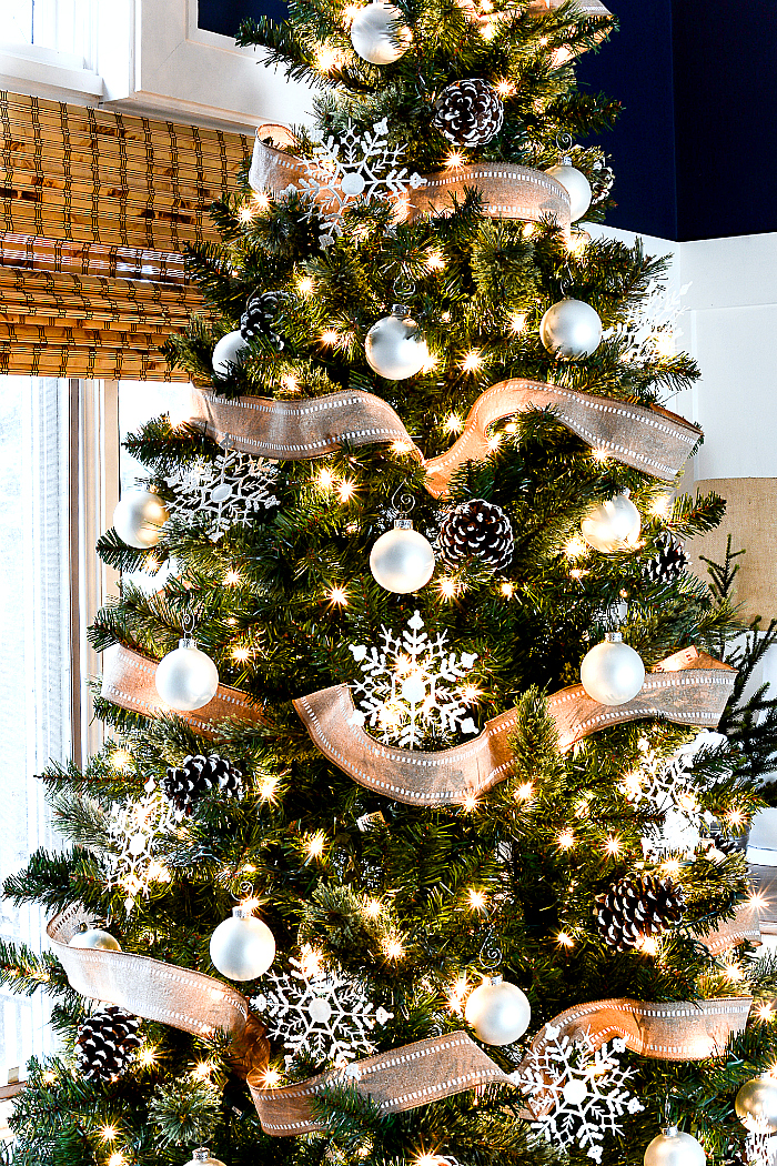 Christmas tree with burlap ribbon pine cones it all for Burlap ribbon on tree