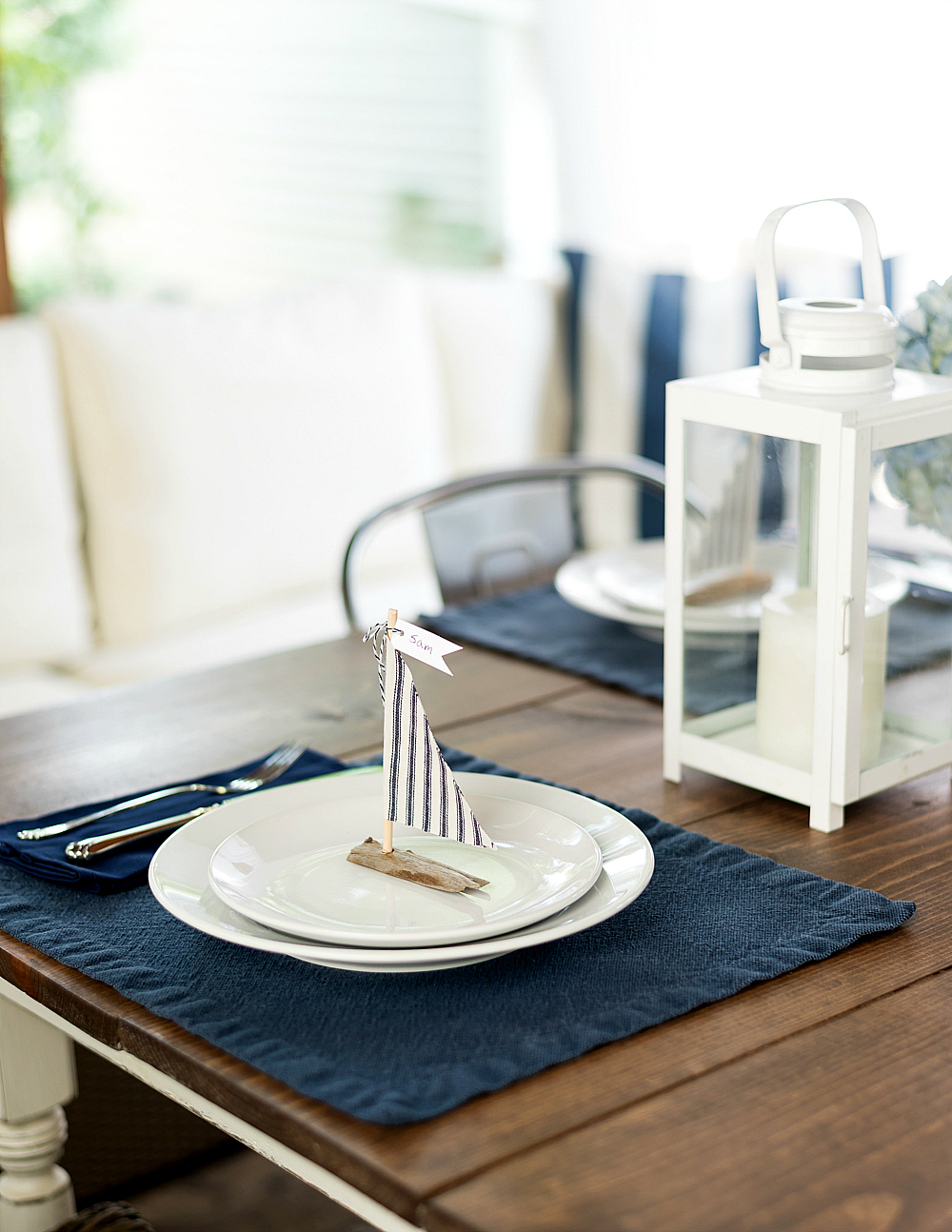 Wedding table setting ideas in navy white sailboats from driftwood