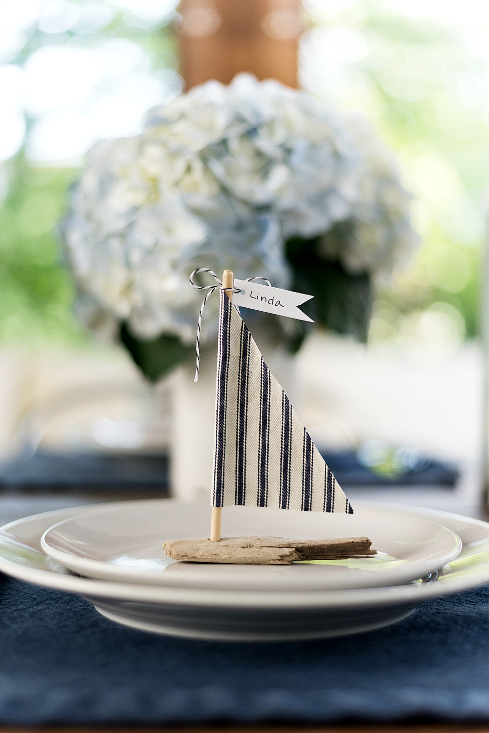 Navy, white table setting idea for summer wedding