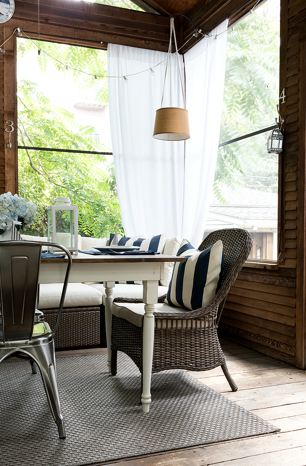Navy white screen porch decor and summer table setting