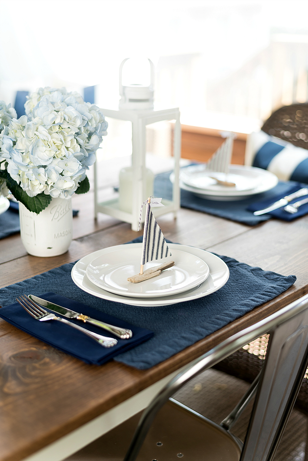 nautical table setting with driftwood sailboats