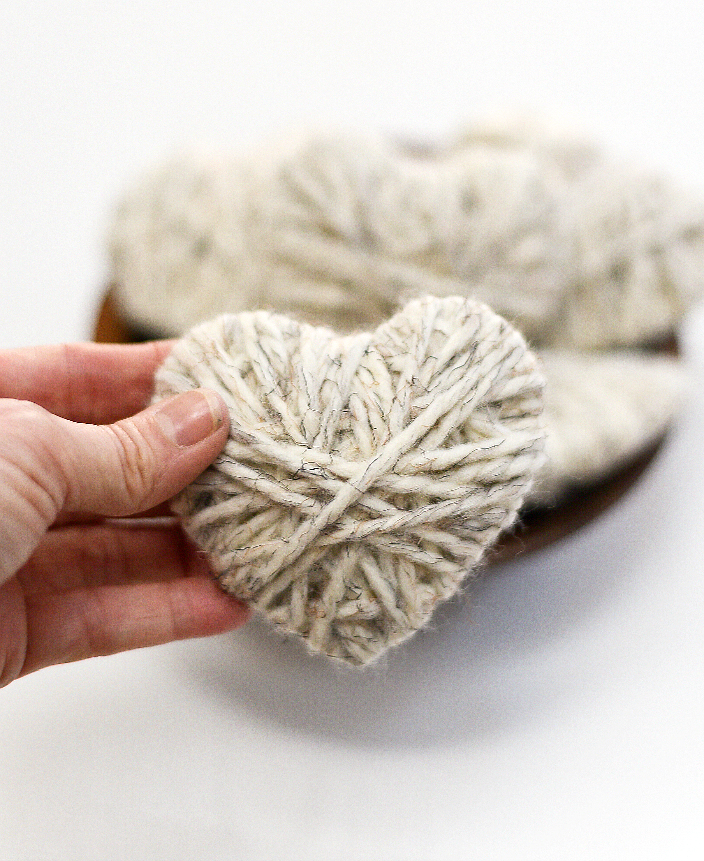 Neutral Valentine's Day Decor Ideas with Yarn Wrapped Hearts