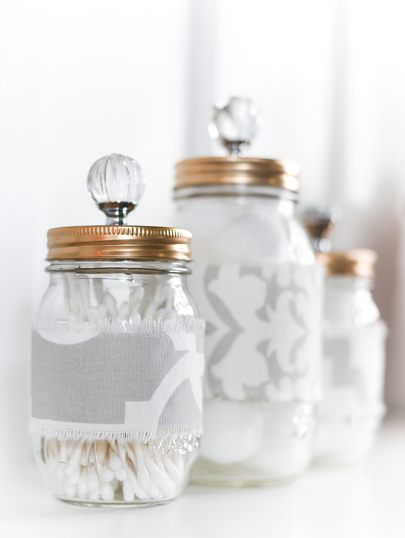 fabric covered mason jars - easy mason jar craft project with fabric - mason jar cozies - mason jar storage for bathroom