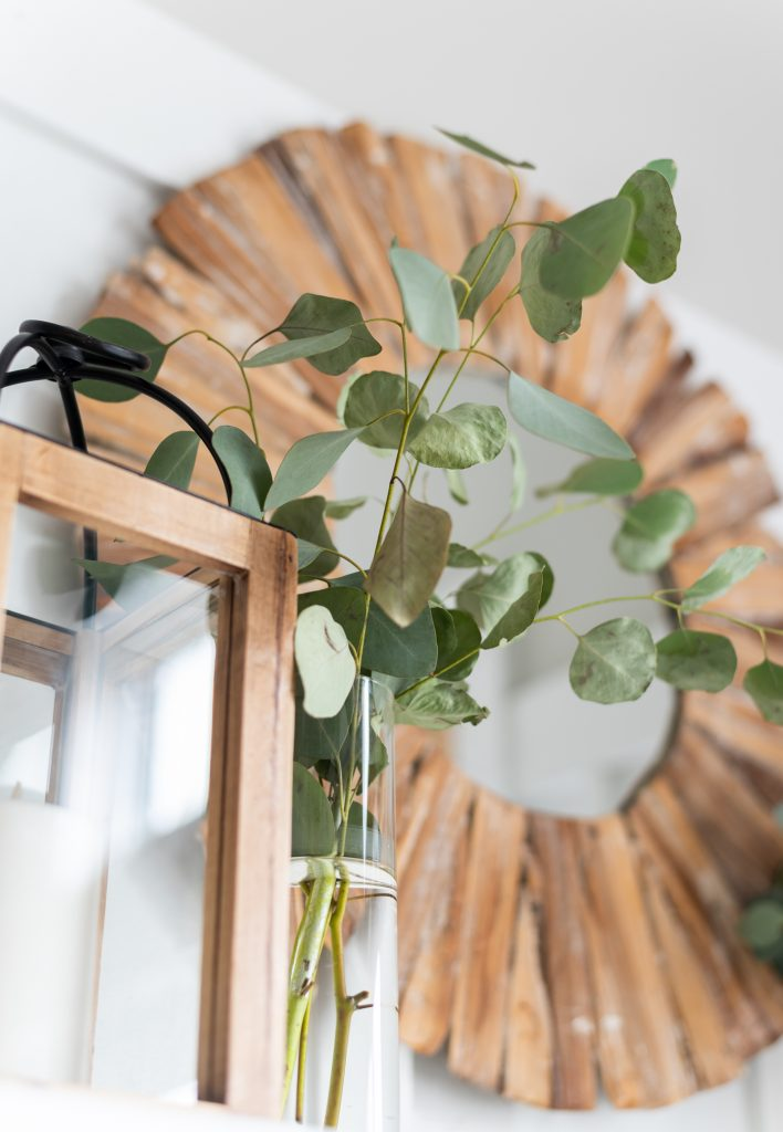 Simple mantel with lanterns and eucalyptus