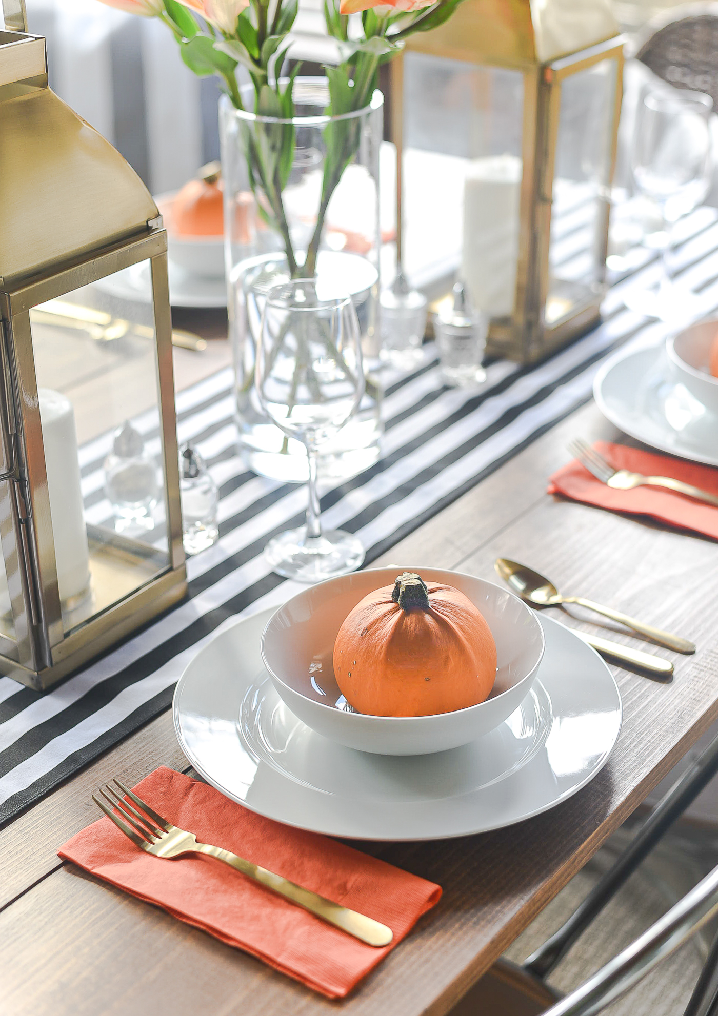 Fall Table Setting in Orange, Black & White - Black White Striped Table Runner - Pumpkins, Orange Napkins, White Plates, Gold Flatware