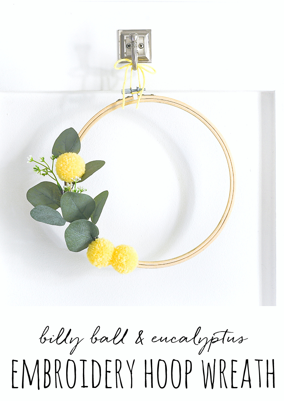 Embroidery Hoop Wreath with Faux Billy Ball Pom Poms - Yellow Summer Wreath Idea. Summer Embroidery Hoop Wreath in yellow with eucalyptus.