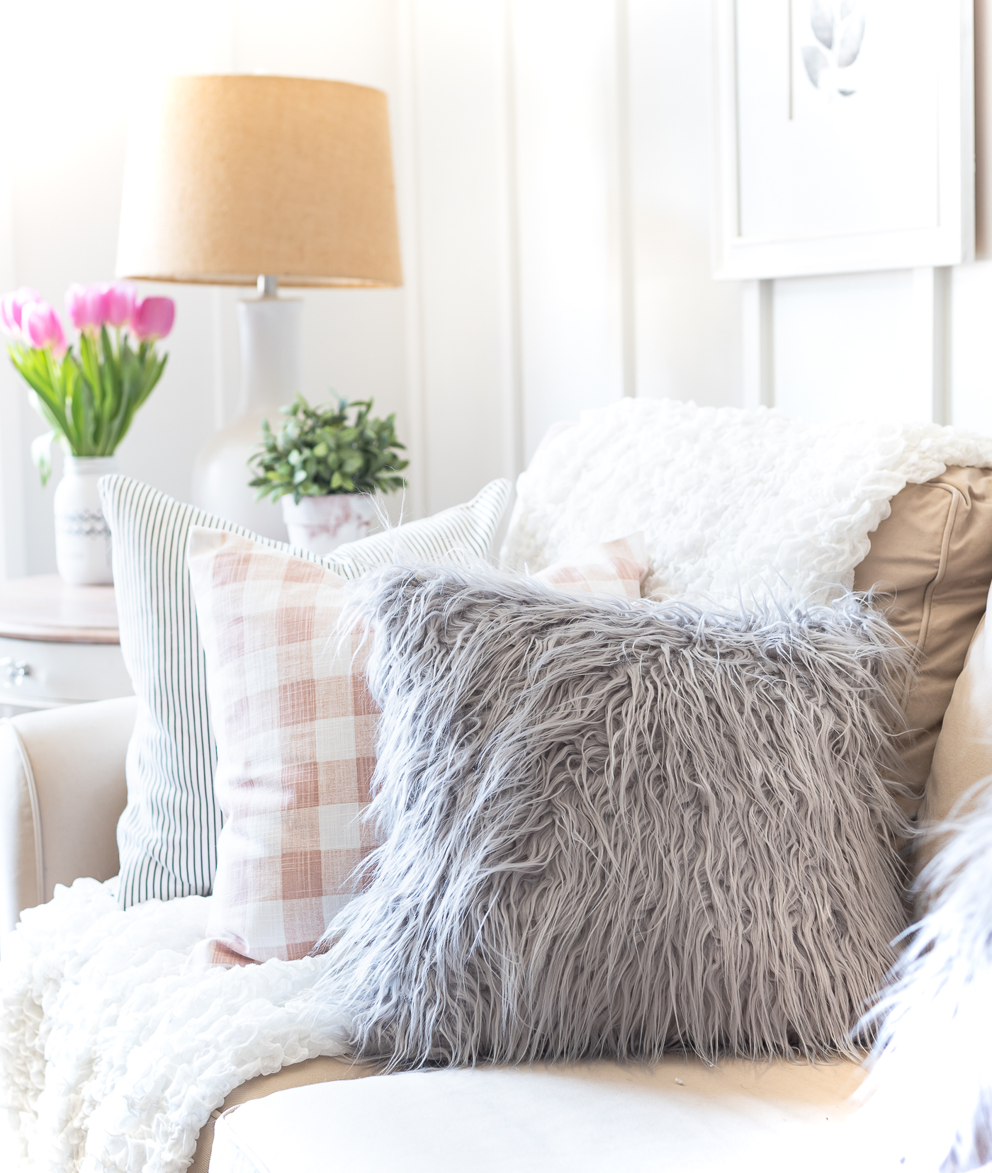 Spring decorating ideas in pink and gray -furry gray pillow